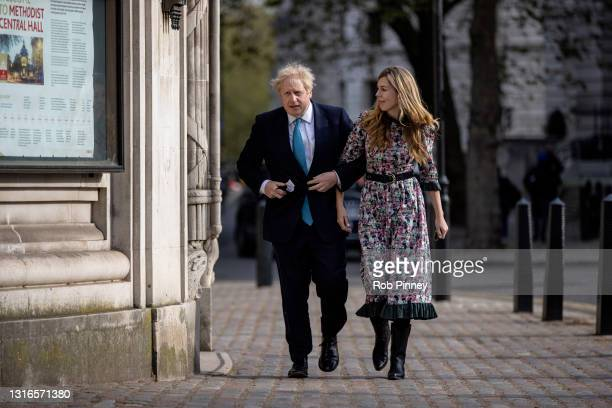 Prime Minister Boris Johnson and his fiancée Carrie Symonds arrive at Methodist Central Hall in Westminster to vote on May 06, 2021 in London,...