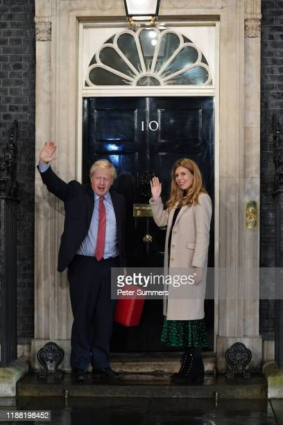 Prime Minister Boris Johnson and his partner Carrie Symonds enter Downing Street as the Conservatives celebrate a sweeping election victory on...