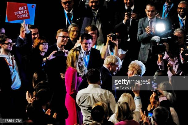 Prime Minister Boris Johnson and his partner Carrie Symonds meet party members after he delivered his keynote speech on the final day of the...
