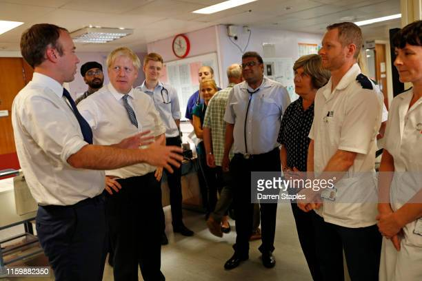Prime Minister Boris Johnson and Matt Hancock Secretary of State for Health and Social Care speak with staff members during a visit to Pilgrim...