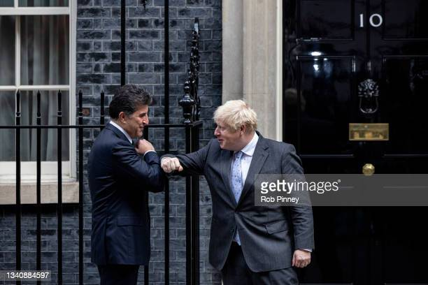 Prime Minister Boris Johnson and President of Kurdistan Region Nechirvan Barzani greet each other with an elbow bump at 10 Downing Street on...