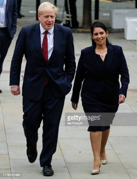 Prime Minister Boris Johnson and Priti Patel Secretary of State for the Home Department walk to attend the speech by Sajid Javid Chancellor of the...