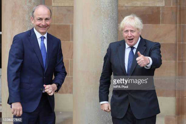 Prime Minister Boris Johnson and Taoiseach Micheal Martin greet each other at Hillsborough Castle during the Prime Minister's visit to Belfast on...