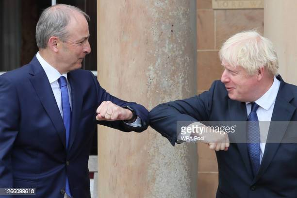 Prime Minister Boris Johnson and Taoiseach Micheal Martin greet each other with an elbow bump at Hillsborough Castle during the Prime Minister's...