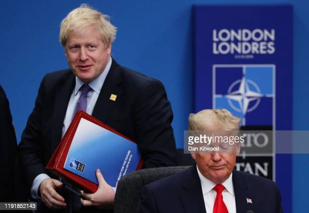Prime Minister Boris Johnson and US President Donald Trump attend the NATO summit at the Grove Hotel on December 4 2019 in Watford England France and...