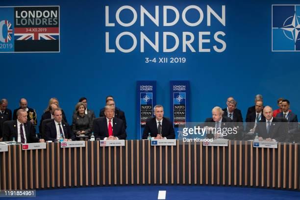 Prime Minister Boris Johnson and U.S. President Donald Trump listen to NATO Secretary General Jens Stoltenberg while attending the NATO summit at the...