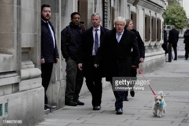 Prime Minister Boris Johnson arrives to cast his vote at Methodist Hall polling station on December 12 2019 in London England The current...