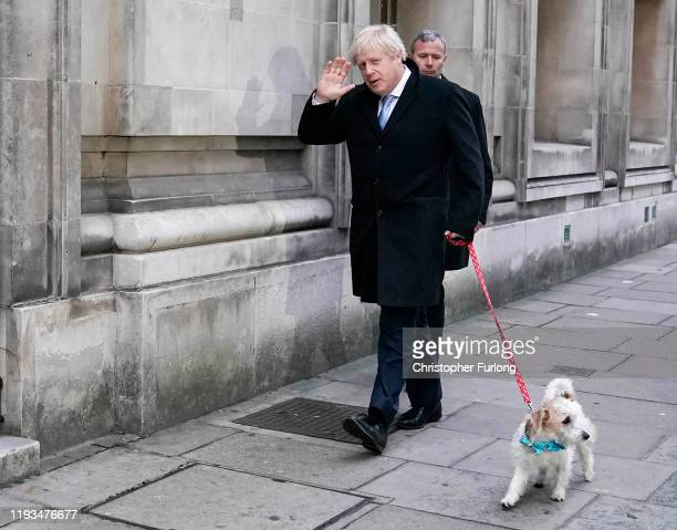 Prime Minister Boris Johnson arrives to cast his vote with dog Dilyn at Methodist Hall polling station on December 12 2019 in London England The...