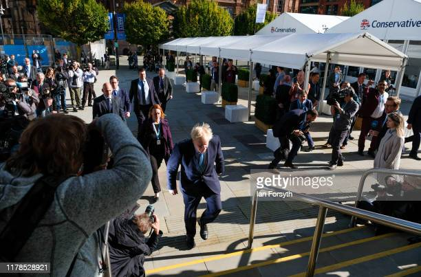 Prime Minister Boris Johnson arrives to deliver his keynote speech on the final day of the Conservative Party Conference at Manchester Central at...