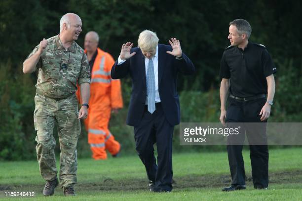 Prime Minister Boris Johnson arrives to meet emergency crews at Whaley Bridge Football Club in Derbyshire as work continued at Toddbrook reservoir...