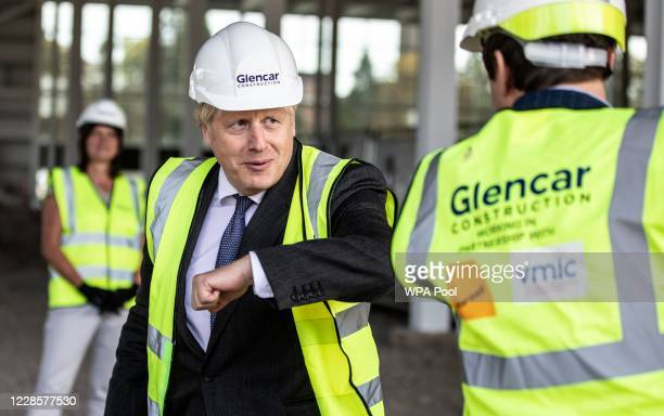 Prime Minister Boris Johnson bumps elbows with scientists as he visits the construction site of the new vaccines Manufacturing and Innovation Centre...