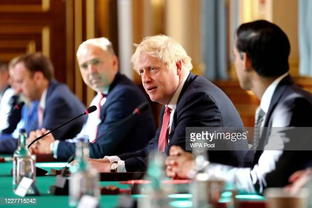 Prime Minister Boris Johnson chairs a face-to-face meeting of his cabinet team of ministers, the first since mid-March, at the Foreign and...