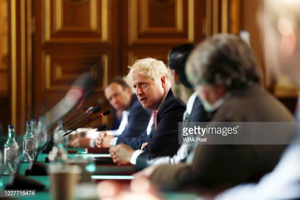 Prime Minister Boris Johnson chairs a face-to-face meeting of his cabinet team of ministers, the first since mid-March, on July 21, 2020 in London,...