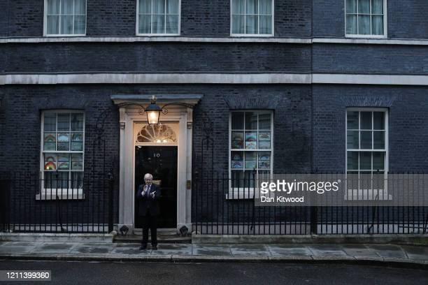 Prime Minister Boris Johnson claps outside 10 Downing Street on April 30 2020 in London England Following the success of the Clap for Our Carers...
