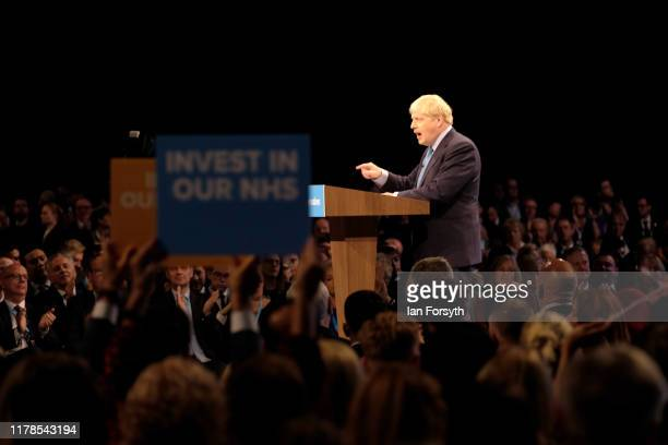 Prime Minister Boris Johnson delivers his keynote speech on the final day of the Conservative Party Conference at Manchester Central at Manchester...