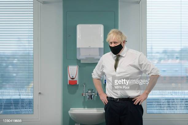 Prime Minister Boris Johnson during a visit to view the vaccination programme at Chase Farm Hospital, part of the Royal Free London NHS Foundation...