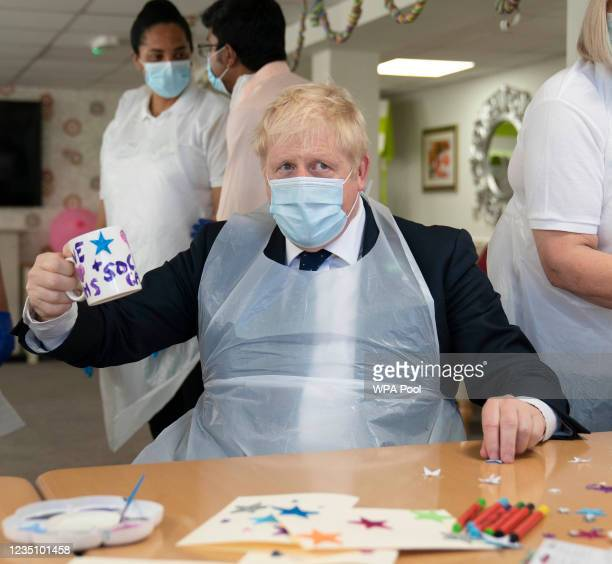 Prime Minister Boris Johnson during a visit to Westport Care Home in Stepney Green, ahead of unveiling his long-awaited plan to fix the broken social...