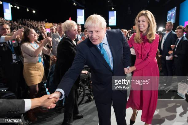 Prime Minister Boris Johnson exits the hall with his girlfriend Carrie Symonds following his keynote speech on day four of the 2019 Conservative...