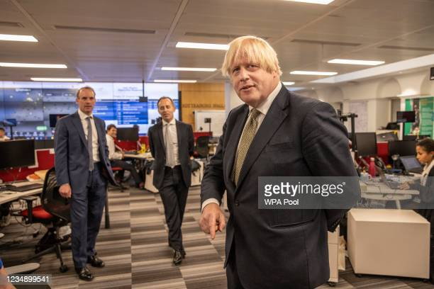 Prime Minister Boris Johnson , Foreign Secretary Dominic Raab and Director General, Tom Drew during a visit to The Foreign, Commonwealth and...