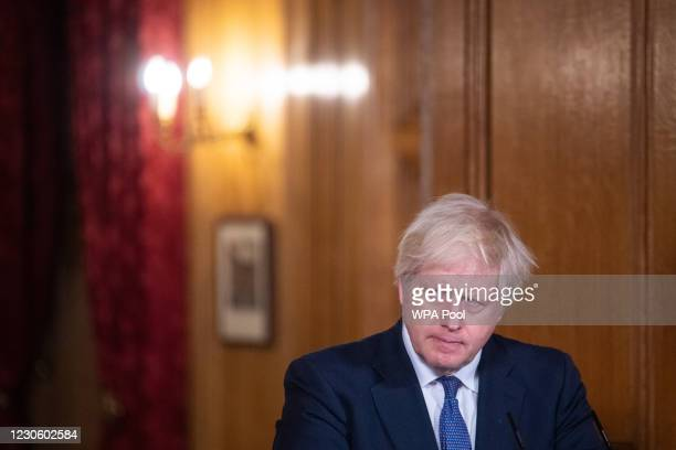 Prime Minister Boris Johnson frowns during a media briefing on coronavirus at Downing Street on January 15, 2021 in London, England.