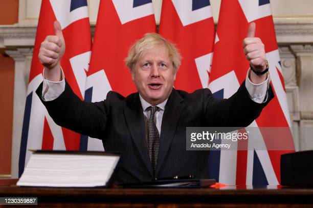 Prime Minister Boris Johnson gestures after signing the Brexit Trade Deal with the EU in 10 Downing Street in London, United Kingdom on December 30,...