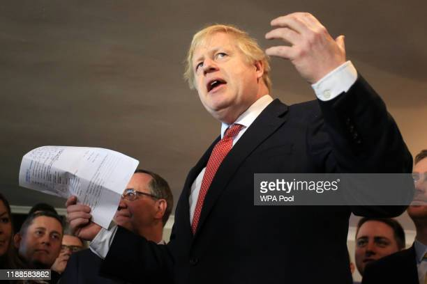Prime Minister Boris Johnson gestures as he speaks to supporters on a visit to meet newly elected Conservative party MP for Sedgefield, Paul Howell...