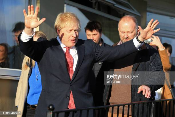 Prime Minister Boris Johnson gestures during a visit to meet newly elected Conservative party MP for Sedgefield Paul Howell at Sedgefield Cricket...