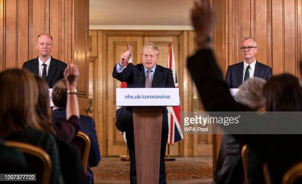 Prime Minister Boris Johnson gives a press conference on the ongoing situation with the coronavirus pandemic with chief medical officer Chris Whitty...