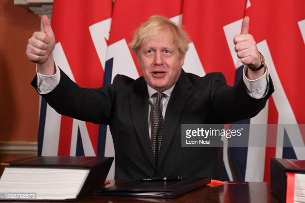 Prime Minister, Boris Johnson gives a thumbs up gesture after signing the Brexit trade deal with the EU in number 10 Downing Street on December 30,...
