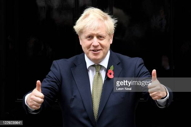 Prime Minister Boris Johnson gives a thumbs up gesture as he poses with fundraisers for The Royal British Legion's Poppy Appeal outside Downing...