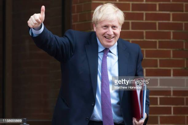 Prime Minister Boris Johnson gives a thumbs up sign after meeting the First Minister of Wales Mark Drakeford in the National Assembly for Wales on...