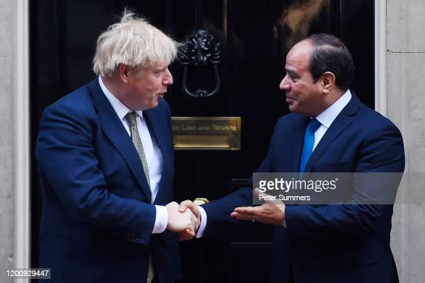 Prime Minister Boris Johnson greets Egyptian President Abdel Fattah elSisi outside 10 Downing Street on January 21 2020 in London England