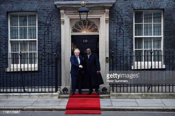 Prime Minister Boris Johnson greets Kenyan President Uhuru Kenyatta outside 10 Downing Street on January 21 2020 in London England