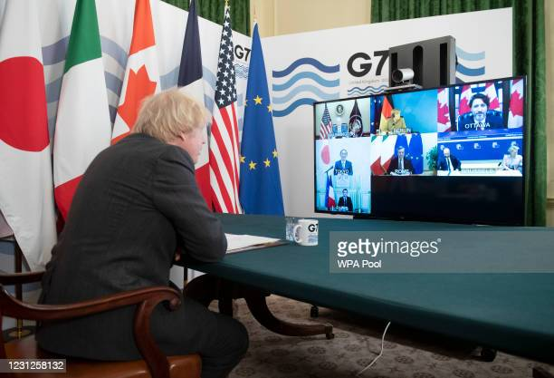 Prime Minister, Boris Johnson hosts a virtual meeting of G7 leaders in the Cabinet Room at Number Ten, Downing Street on February 19, 2021 in London,...
