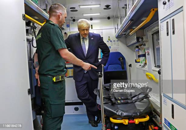 Prime Minister Boris Johnson inspects an ambulance during a visit to Pilgrim Hospital on August 5 2019 in Boston England Boris Johnson has announced...