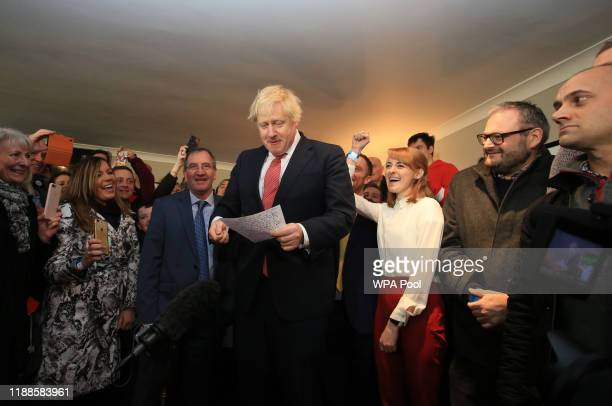 Prime Minister Boris Johnson is cheered by supporters as he speaks to supporters on a visit to meet newly elected Conservative party MP for...