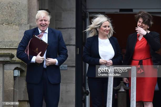 Prime Minister Boris Johnson is greeted by First Minister, Arlene Foster of the DUP and Deputy First Minister Michelle O'Neill of Sinn Fein at...