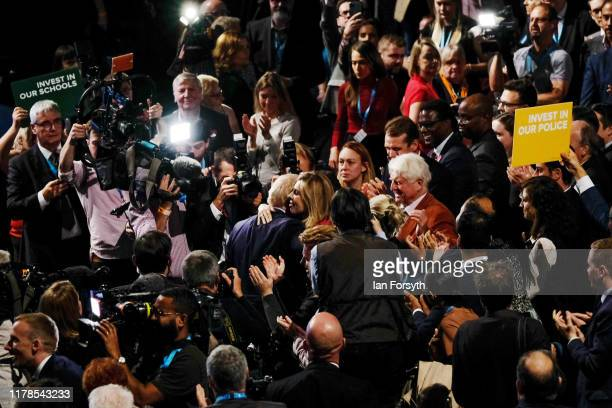 Prime Minister Boris Johnson is hugged by his partner Carrie Symonds after he delivered his keynote speech on the final day of the Conservative Party...