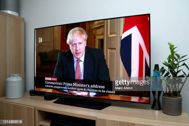 Prime Minister Boris Johnson is seen in a televised address to the Nation announcing new restrictions requiring the general public to stay at home...