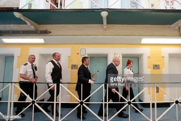 Prime Minister Boris Johnson is taken on a tour during a visit to Leeds prison on August 13 2019 in Leeds England In an announcement on Sunday...
