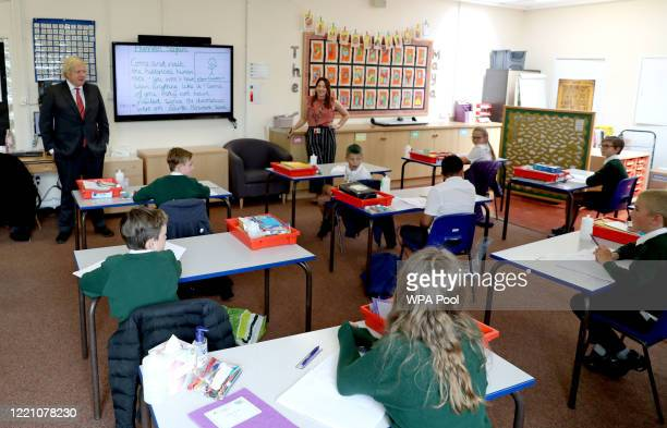 Prime Minister Boris Johnson joins a socially distanced lesson during a visit to Bovingdon Primary School on June 19, 2020 near Hemel Hempstead. The...
