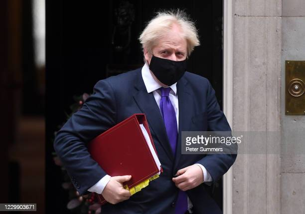 Prime Minister Boris Johnson leaves 10 Downing Street after it was announced that the UK Government has approved the Pfizer/BioNTech Covid vaccine...
