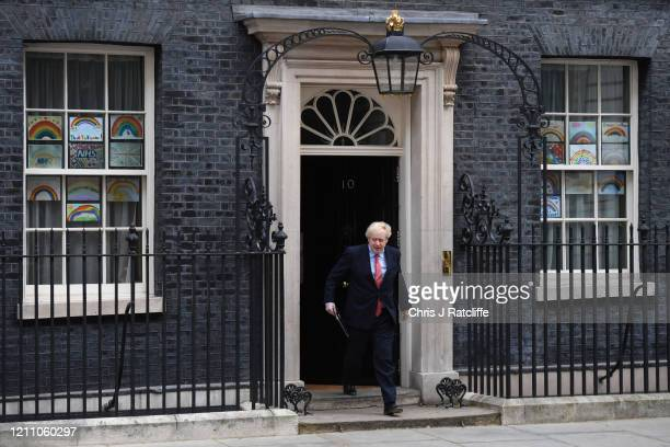 Prime Minister Boris Johnson leaves 10 Downing Street before making a speech as he returns to work following his recovery from Covid-19 on April 27,...
