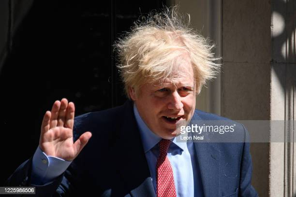 Prime Minister Boris Johnson leaves 10 Downing Street for PMQs on May 20, 2020 in London, United Kingdom. The British government has started easing...