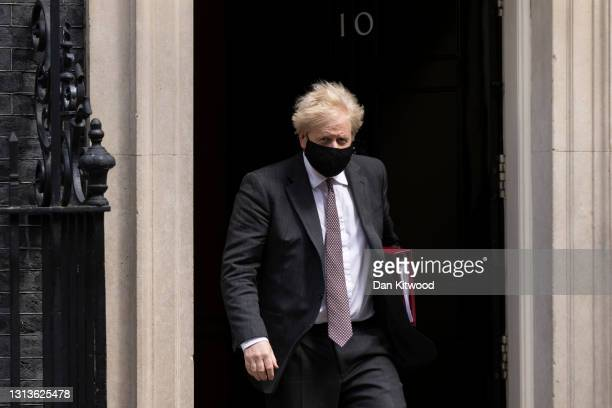 Prime minister Boris Johnson leaves 10 Downing Street to attend the weekly Prime Ministers Questions in Parliament on April 21, 2021 in London,...