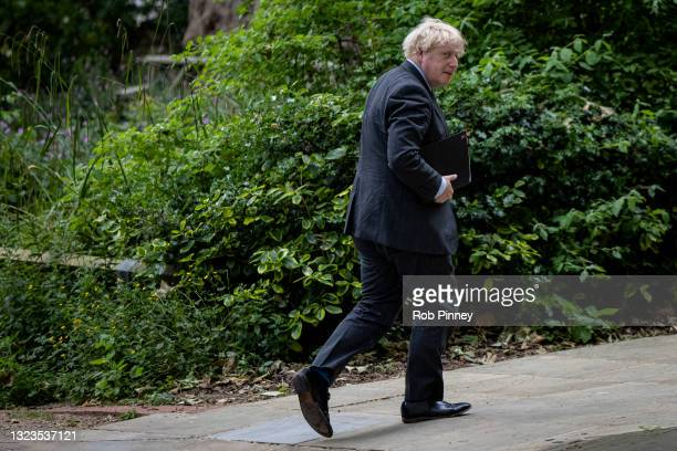 Prime Minister Boris Johnson leaves 10 Downing Street to delivery a press conference on June 14, 2021 in London, England. Under the current timeline,...