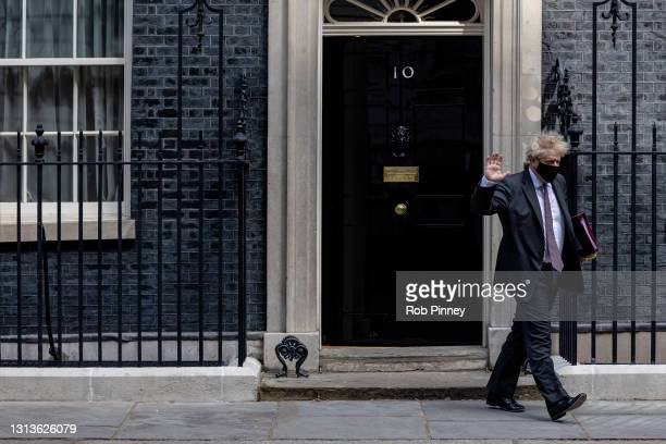 Prime minister Boris Johnson leaves 10 Downing Street to head to Parliament for Prime Minister's Questions, on April 21, 2021 in London, England.