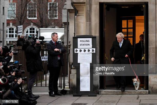 Prime Minister Boris Johnson leaves after casting his vote with dog Dilyn at Methodist Hall polling station on December 12 2019 in London England The...