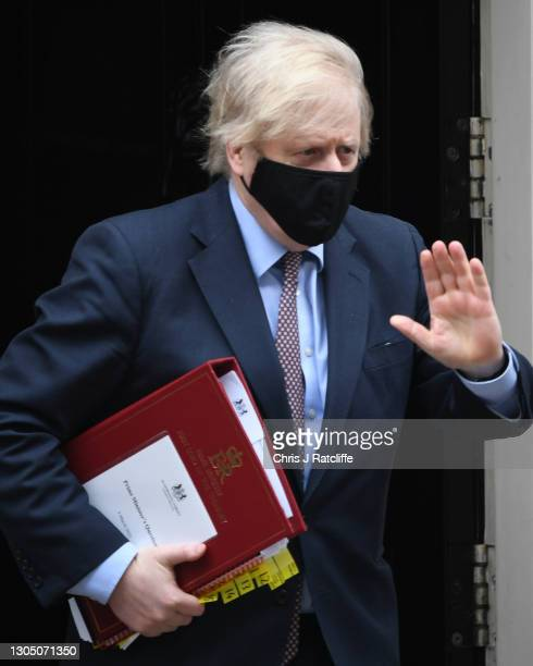 Prime minister Boris Johnson leaves Downing Street ahead of the Chancellor of the Exchequer's delivery of the budget on March 3, 2021 in London,...