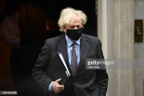 Prime minister Boris Johnson leaves Downing Street on his way to the House of Commons to deliver a statement on the governments four-step plans to...